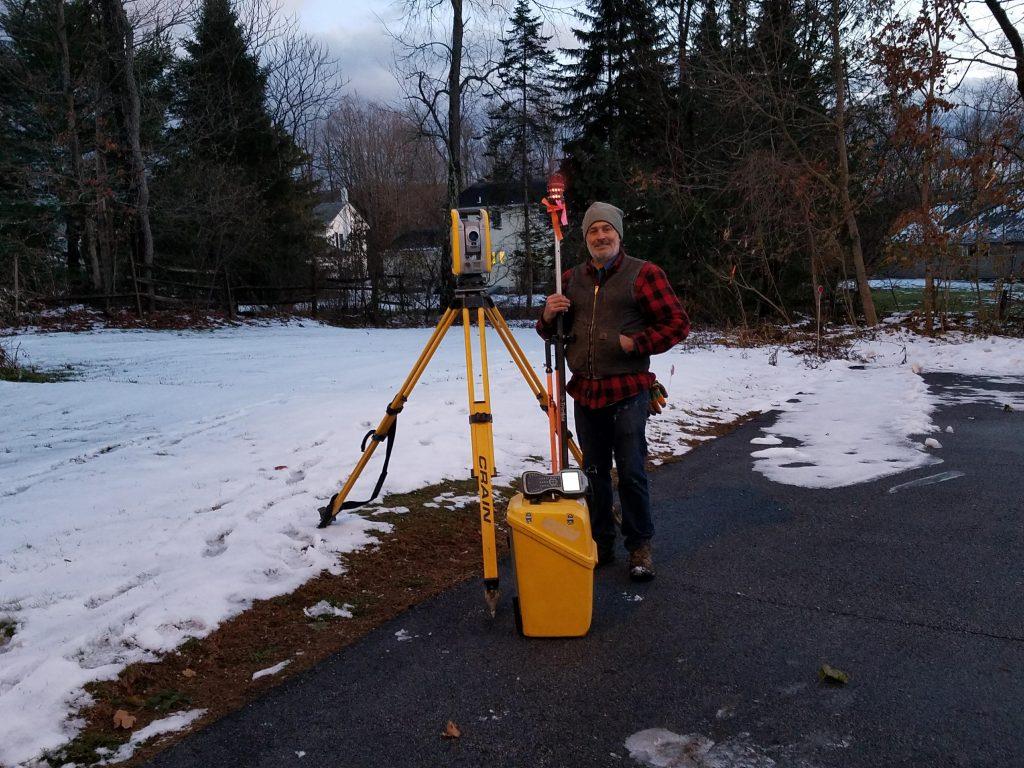 David Spurr surveying property